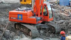 Red excavator on a construction site Stock Footage