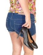 Girl carrying her heels. - stock photo