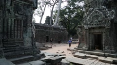 People in Angkor Thom temple complex in Cambodia Stock Footage