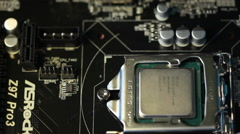 Man's hand installing Intel processor socket Stock Footage