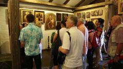 People at excursion inside Radomysl Castle, the museum of Ukrainian home icons Stock Footage