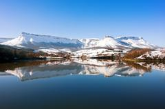 Sierra Salvada with lake reflections - stock photo