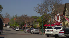 View of cars parked along the road in Solvang Stock Footage