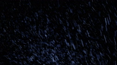 Snow falling background. Stock Footage