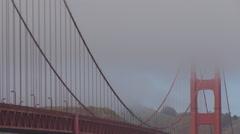 Closeup Golden Gate Bridge San Francisco traffic car foggy day fog pass icon USA Stock Footage