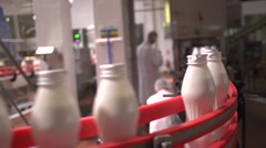 Fresh dairy products plant - white yogurt bottles on a conveyor Stock Footage