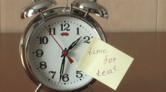 "An alarm clock and a yellow note with this text: ""time for teat "" Stock Footage"