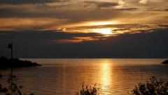 Stock Video Footage of Lake Sunset With Golden Clouds 04