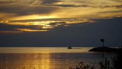 Stock Video Footage of Lake Sunset With Golden Clouds and Boats 01