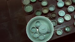 Many Chinese teacups in antique shop in Shanghai. Stock Footage