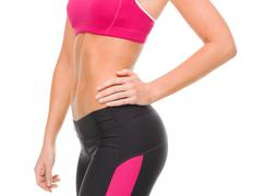 Close up of female abs in sportswear Stock Photos