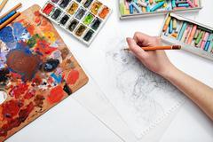 Artist draws sketch Stock Photos