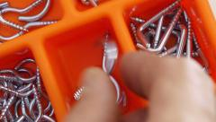 Plastic box with the screws. Stock Footage