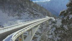 AERIAL: Concrete bridge on mountain pass in winter Stock Footage