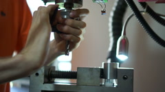 Millign machine smooths surfaces on aluminum cylinder. - stock footage