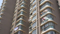 Laundry hanging to dry outside Shanghai apartment building. Stock Footage