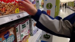 Man checking cereal ingredient in grocery store - stock footage