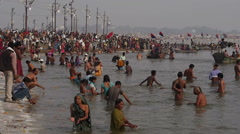 Pilgrims Bathing in the Ganges at Kumbh Mela Festival in Allahabad, India Stock Footage
