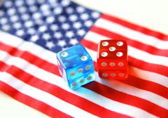 Bet on america. flag and dices concept Stock Photos
