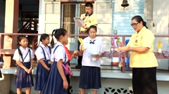 Teacher awarded to students. Elementary School, Bangkok Thailand Stock Footage