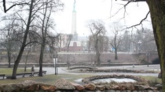 Park view of Latvian monument of freedom in a cloudy day Stock Footage