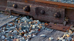 Closeup of railroad connector, wooden planks, 4K Stock Footage