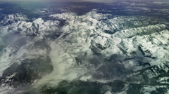 Aerial view over snow-capped Rocky Mountains, 4K - stock footage