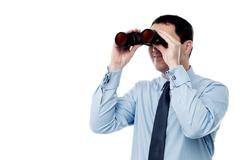 Middle aged  business man with binocular Stock Photos