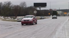 car on icy road - stock footage