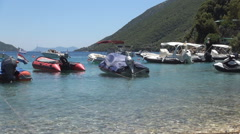 Many boats waiting in port near a beach. Ionian island. Mediterranean bay. Stock Footage