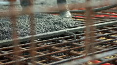 Workers team working on concreting at construction site. View through the wire. Stock Footage