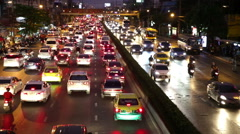 Bangkok traffic red tail lights flowing on Rama IV road timelapse Stock Footage