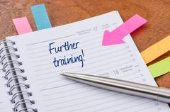 Daily planner with the entry Further training - stock photo