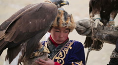 Golden eagle on the hand girl Stock Footage