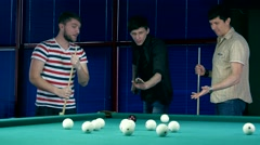Several young men discussing game of billiards Stock Footage