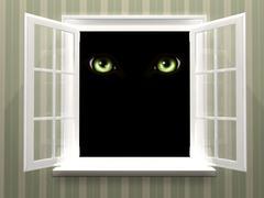 Eyes of monster  in open window Kuvituskuvat