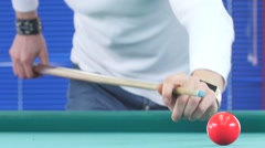 Guy takes aim, to make an impact on a billiard ball Stock Footage