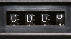 Old mechanical counter counts numbers - macro Stock Footage