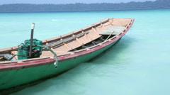 Wood motorboat on a tropical island Stock Footage