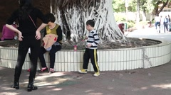 China children play blowing bubbles Stock Footage