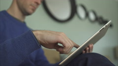 A Man on a Sofa Using The Latest Technology in 4K (7 of 9) Stock Footage