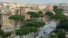Tourists walking near the Colosseum in Rome, Italy. Panning shot Stock Footage