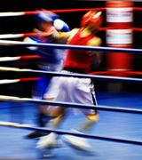 Two blurring boxers fighting at the ring - stock photo