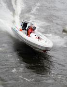 Speedboat racing along on a river - stock photo