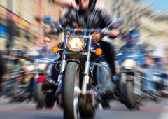 Blurred bike riders rushing at city street Stock Photos