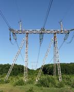 Electricity pylon power pole high voltage against blue sky - stock photo