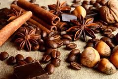 Aromatic set of chocolate,coffee,anise and cinnamon on linen.. - stock photo