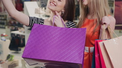Two happy friends is taking selfie while shopping in mall Stock Footage