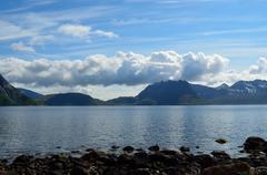 summer mountain range and fjord landscape on the island of senja - stock photo