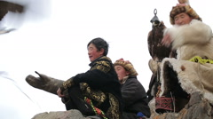 Golden eagle takes off from the boy's hand Stock Footage